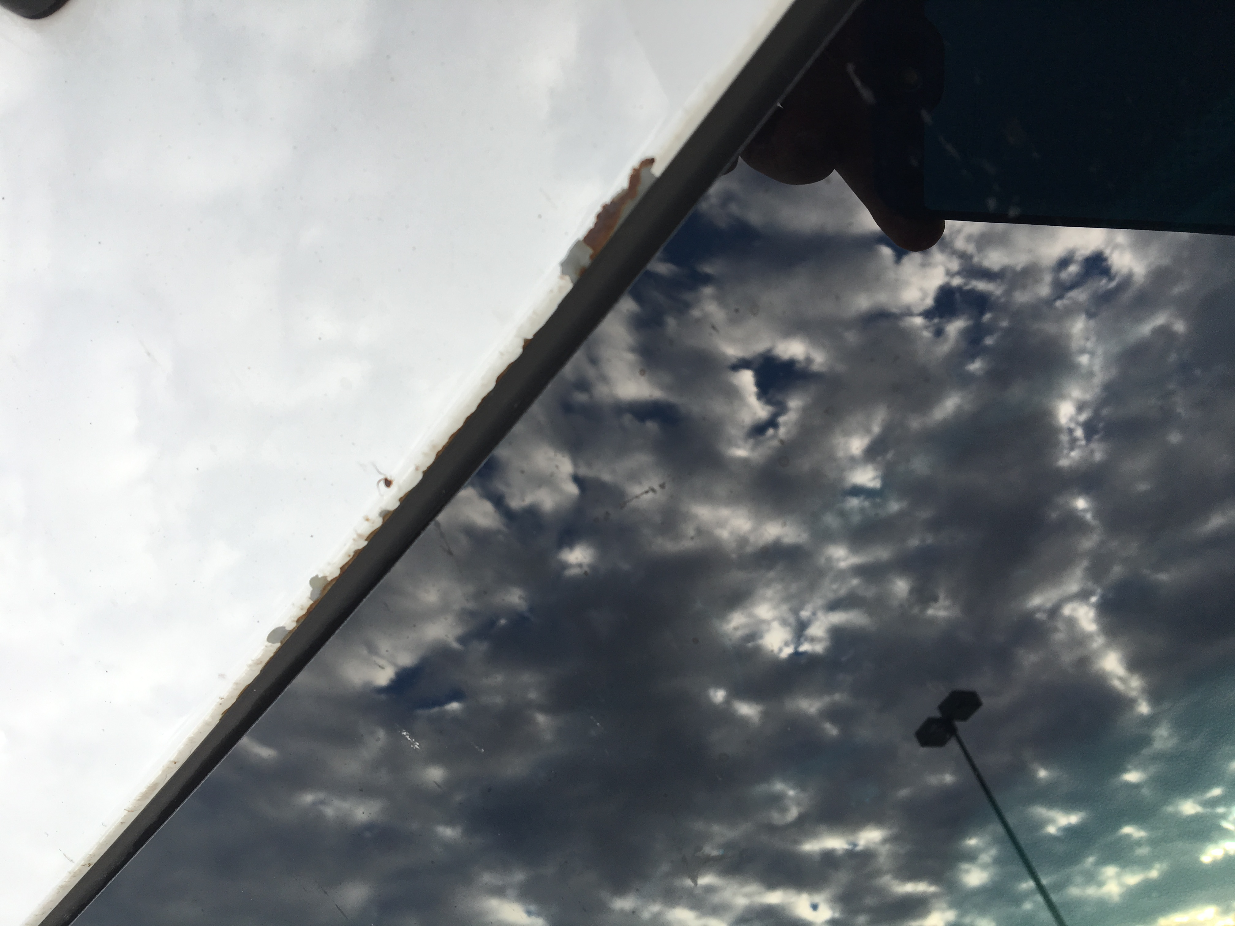Fixing chipped paint above windshield